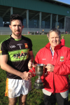Captain Rory Byrne receiving the Mayo GAA Senior Football League Division 1A cup from Mike Connelly