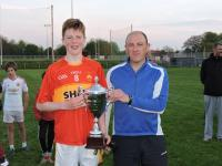 U-14 Captain Paddy Heneghan being presented with the cup