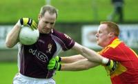 Tom Nallen shrugs aside the challenge of Castlebar's Eamonn Tiernan in the 2006 Qtr Final