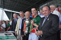 Dr Micky presenting Kilcoyne Cup to Mayo Minor Captain 2013