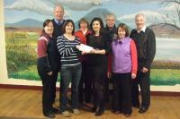 Caroline Lavin presenting Caroline Hanahoe Kinard Crossmolina with a cheque for €6350