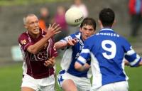 Crossmolina captain Ciaran McDonald in action against Breaffy's Aidan O'Shea
