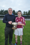 Ronan Callaghan receives NM Minor A Cup from Ml McKenzie North Chairman