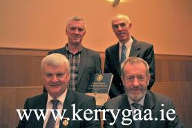 John O'Leary (PRO Kerry Co Comm) & Tommy O'Connor (Author & NKHB D'vlmt Officer) standing with the current Uachtarán of the GA