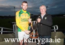 Aidan McCabe Capt of the victorious Kilmoyley Team accepting the Credit Union Senior Hurling League Cup from Hurling Officer Ker
