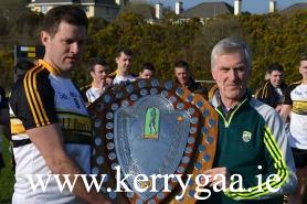 John O'Leary PRO Kerry Co Committee presenting the Div 1 SFL Shield 15 to Eoin Brosnan the Dr Crokes Captain