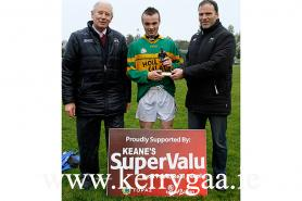 Eamon Whelan  Presenting man of match  trophy to Colin Enright of  Moyvane-Tarbert