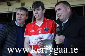Dingle captain receiving The Frank King Cup from Patrick O'Sullivan Chairman Kerry Co Committee