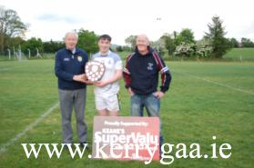 Christy Killeen of the County Committee presented the Div 4 Shield to winning captain Cathal Ferriter