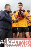 Assistant Secretary of the County Committee Stephen O'Sullivan presented the winner's shield to Emmets captain Ciaran Pierce