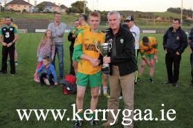 Gneeveguilla Captain Timmy Brosnan man accepts the McElligott Cup from County PRO John O'Leary