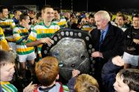 Gerard Lane Presents Kelleher Shield to Kevin McMahon