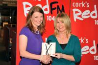 Tracey Kennedy makes a presentation to RedFM CEO Fiona Darcy on behalf of SHL Committee