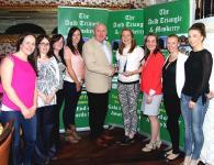 Rena Buckley Inniscarra Winner September Muskerry GAA/Auld Triangle Sports Star Award receiving trophy from Michael O'Riordan
