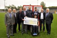 Coiste Chontae Presentation to Jamie Wall Proceeds from Challenge Game v Kilkenny