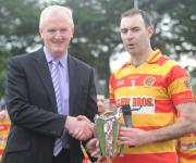 Newcestown Captain John Crowley Receives Seamus Long Cup From County Chairman Ger Lane PIHC 2015