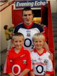 Captain Graham Canty with young fans at training