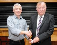 Referee Cathal Egan receives his presentation from Jim Forbes Chairman of Coiste na nOg Central Region