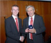 Daniel Lane (Maor Uisce) receives presentation from Jerry O'Sullivan