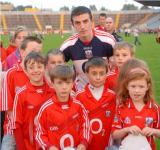 Ray Carey with fans at training