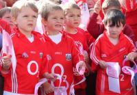 Scoil Eoin's Rebel Infants listen to John Miskella