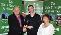 Aidan Ahern Cloughdubh Winner October Muskerry GAA/Auld Triangle Sports Star Award receiving award from Michael O'Riordan