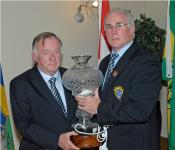 Outgoing Munster PRO Jim Forbes receives a presentation from Sean Walsh at Munster Convention