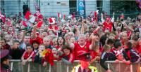 A Sea of Red Awaits the Champions