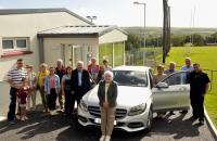 Cork GAA Clubs Draw August Winner. Mary Whooley Argideen Rangers with club officers and family collects her Mercedes C-180