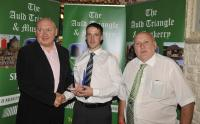 John Carey Dripsey July Winner Muskerry GAA/Auld Triangle Award receives Trophy from Michael O'Riordan and Willie Buckley