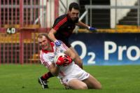 Alan O Connor feels the pain of Down pressure