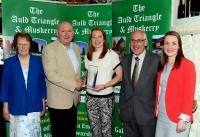 Rena Buckley Inniscarra Winner September Muskerry GAA/Auld Triangle Sports Star Award receiving award from Michael O'Riordan