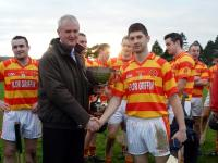Gerard Lane Presents Division 2 Hurling Cup to Niall Twomey (Newcestown)