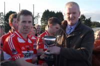 Gerard Lane presents Division 1 Hurling Cup to Seamus Hayes (Courcey Rovers)