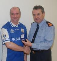 Garda All-Ireland 40x20 Finalist Paddy Donavan receiving his runner-up medal