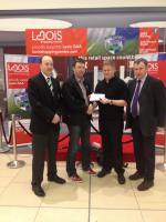 Laois GAA Treasurer Martin Byrne presents a €10,000 cheque to March Club Draw winner Mick Ryan Portlaoise.