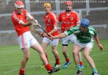 2013 - Laois SHC B - St. Manmans Shane Conroy looks to shoot as Rosenallis Sean O'Neill blocks him down. Pic Denis Byrne.