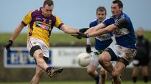 Paddy Byrne, Wexford, in action against James Finn, Laois. Bord na Mona O'Byrne Cup, Group A, Round 1, Wexford v Laois