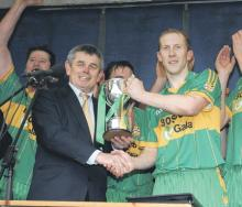 Leinster Council Chairman Martin Skelly Presents Leinster Trophy to Park/Ratheniska Captain, David Larkin