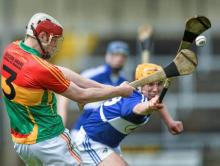 2014 LSHC Round Robin Rd 2 - Laois v Carlow - Paul Doyle, Carlow, in action against John Purcell, Laois