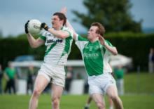 Killeshins' Jeff McDermot claims this breaking ball as Stradballys' Cormac Delaney challenges. Photo Denis Byrne.
