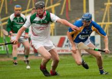 Rathdowney Errills Lar Mahon and Clough Ballacollas Picky Maher have eyes on the ball on Sunday. Pic Denis Byrne.
