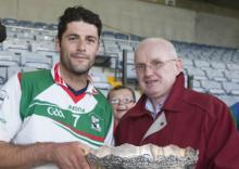 Rathdowney Errill Alan Delaney receives the O'Bradaigh Cup from Laois GAA chairman Gerry Kavanagh.Picture Alf Harveyhrphoto.ie