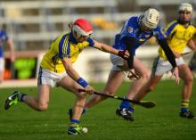 Eoin Reilly of St Lazarians, Abbeyleix tries to get to the ball from Kevin Murphy of Celbridge in the Leinster Intermediate club