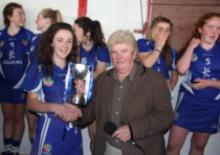 Laois Captain Aoife Hyland receives the cup from Bridghidin Heenan of the Ulster Camogie Association, following Laois' victory o
