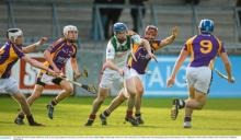 Brian Campion, Rathdowney Errill, in action against Kilmacud Crokes players, from left, Caolan Conway, Dillon Mulligan, Damien K