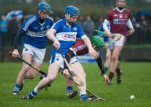 Laois' Brian Campion competes with N.U.I.G's Gerard O'Donohue for this ball in their Walsh Cup clash at Rathdowney on Sunday. Ph