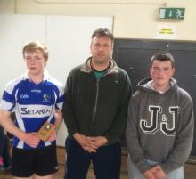 Padraig Delaney being presented with U15 Leinster title by Paul Dowling