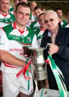 Laois County Board Chairman Gerry Kavanagh presenting Captain Lar Deegan with the Junior Hurling Championship C Cup. Pic Denis B