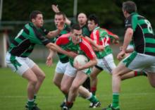 Graiguecullens Liam Kearney in possession and looking to break as Ballyfins James Finn challenges. Photo Denis Byrne.
